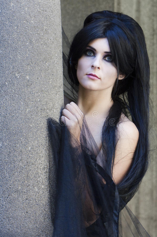 Halloween Mysterious Dressed Gothic Woman. Mysterious woman dressed in black gothic dress stock photos