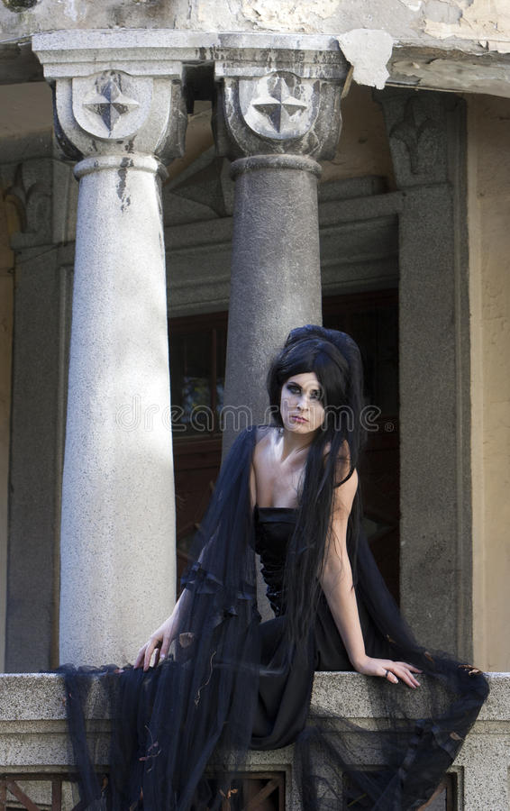 Halloween Mysterious Dressed Gothic Woman. Mysterious woman dressed in black gothic dress royalty free stock image