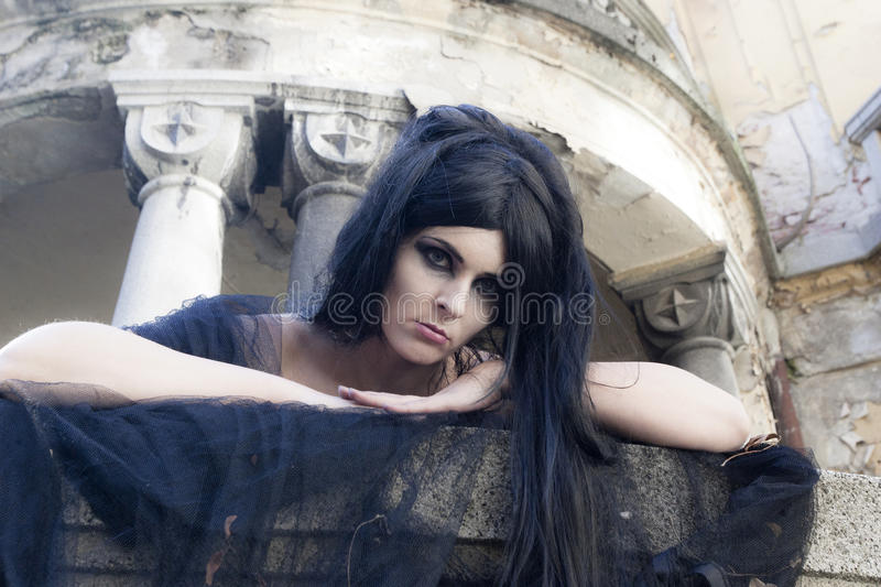 Halloween Mysterious Dressed Gothic Woman. Mysterious woman dressed in black gothic dress royalty free stock photos