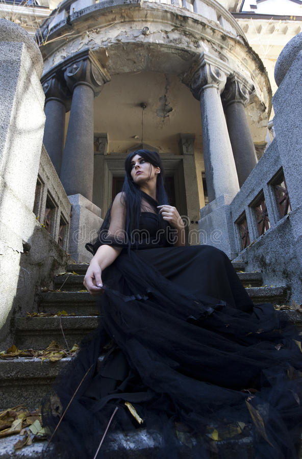 Halloween Mysterious Dressed Gothic Woman. Mysterious woman dressed in black gothic dress stock photo
