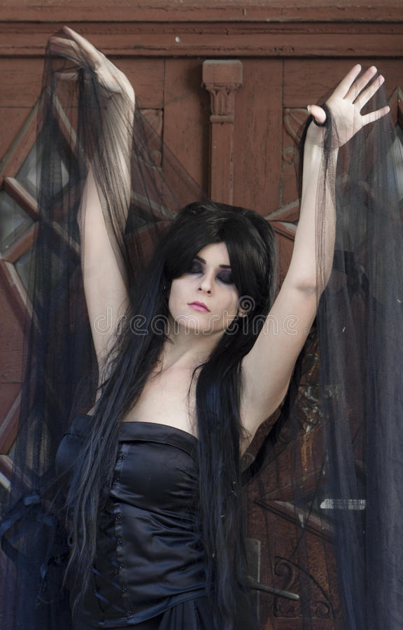 Halloween Mysterious Dressed Gothic Woman. Mysterious woman dressed in black gothic dress royalty free stock images