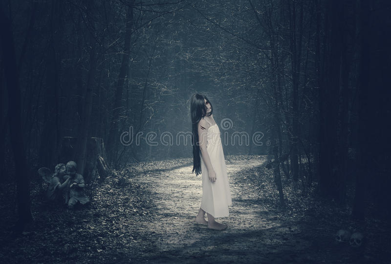 Halloween mystical forest with ghost stock photo