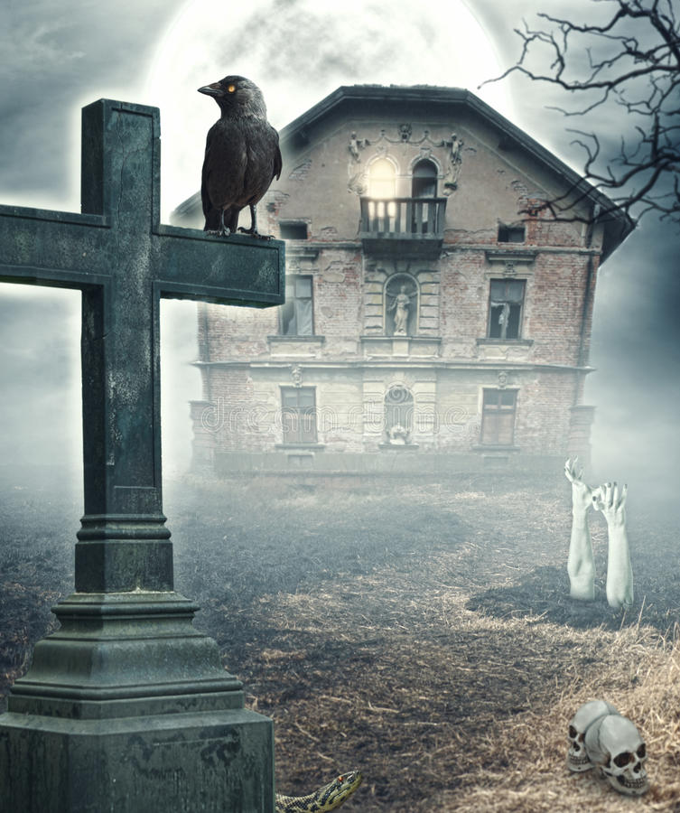 Halloween mystical spooky background with cross and haunted house stock photos