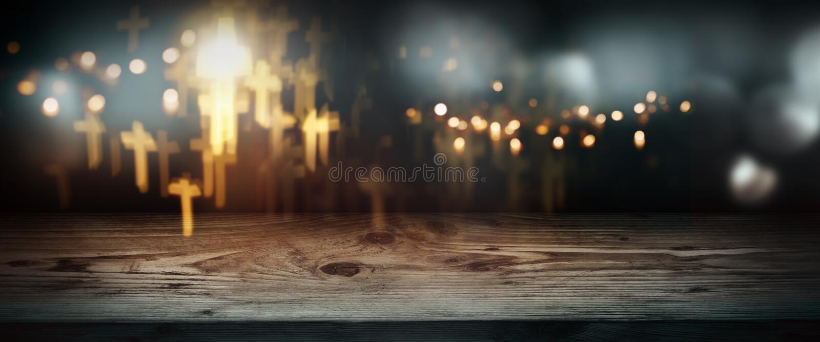 Halloween night with abstract crucifix and lights. In front of old wooden table for a decoration stock images