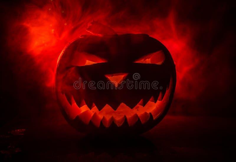 Halloween - old jack-o-lantern on black background. Spooky Halloween background with pumpkin stock photos