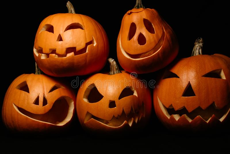 Halloween orange pumpkins. Jack`s lantern for holiday. Halloween pumpkins. Jack`s lantern for holiday on black background royalty free stock photos