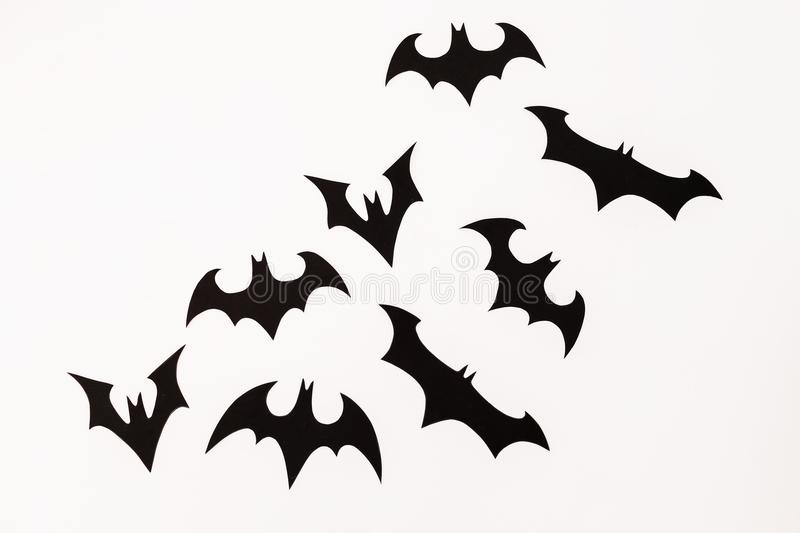 Halloween paper black bats on white background. Flat lay, top view. Halloween paper black bats on white background. Flat lay stock images