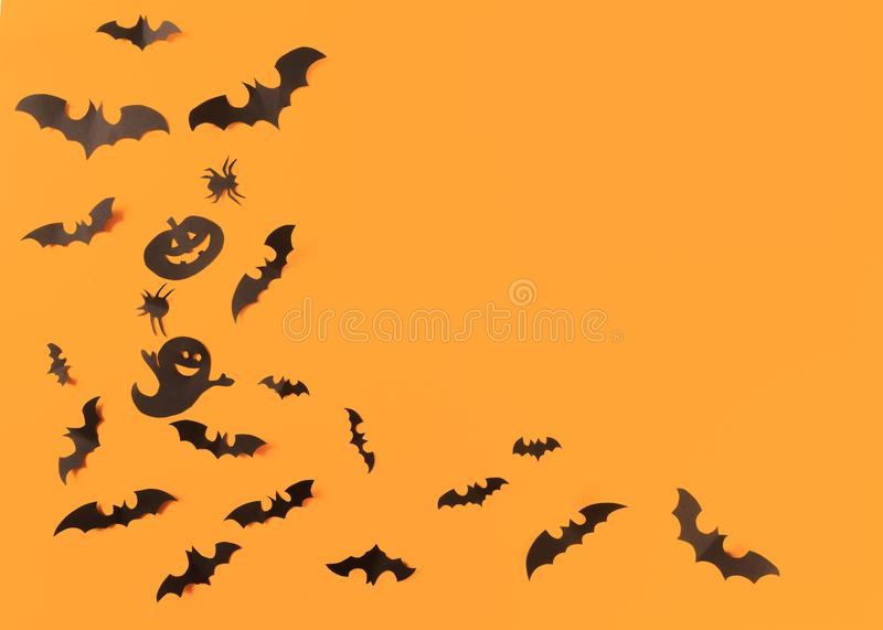 Halloween paper decorations on orange background. Halloween concept. Flat lay, top view, copy space - Image. Halloween paper decorations on orange background stock image