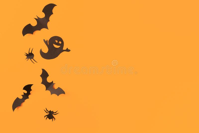 Halloween paper decorations on orange background. Halloween concept. Flat lay, top view, copy space - Image. Halloween paper decorations on orange background stock images