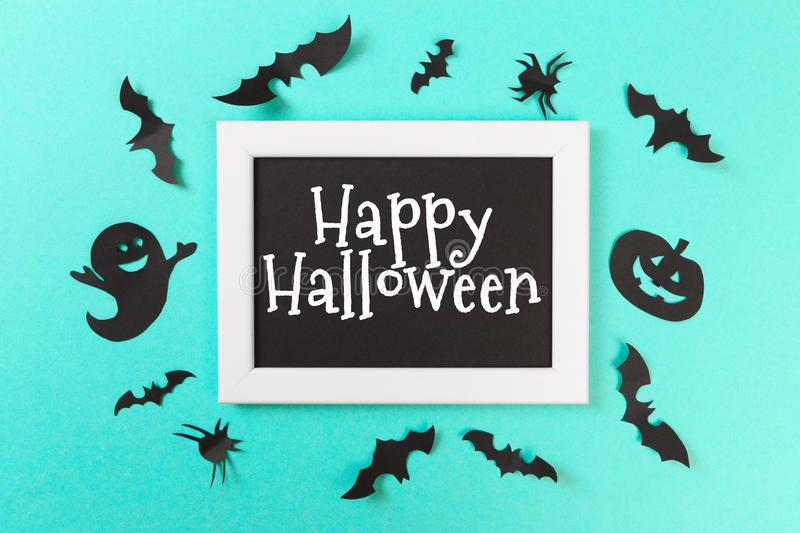 Halloween paper decorations on pastel blue  background. Halloween concept. Flat lay, top view, copy space - Image. Halloween paper decorations on pastel blue royalty free stock image