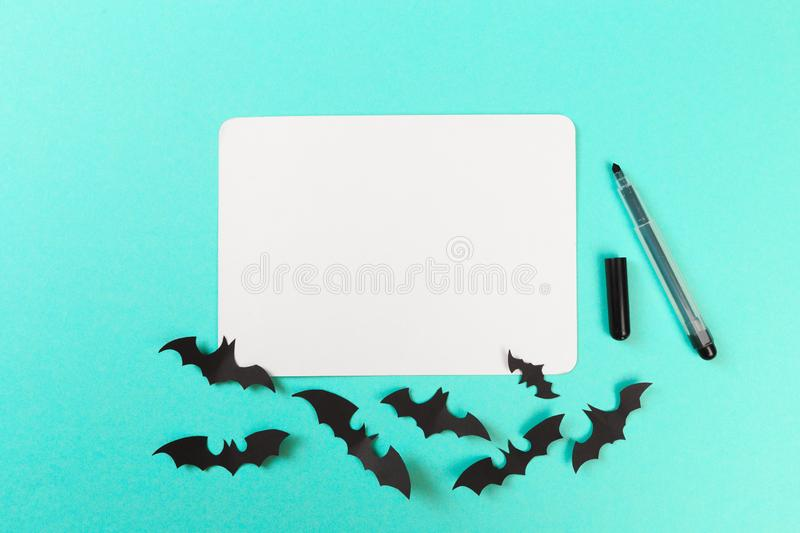 Halloween paper decorations on pastel blue  background. Halloween concept. Flat lay, top view, copy space - Image. Halloween paper decorations on pastel blue stock images
