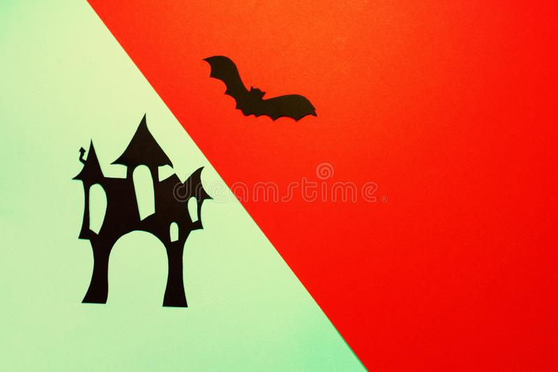 Paper haunted house with bats on blue and red background royalty free stock photography