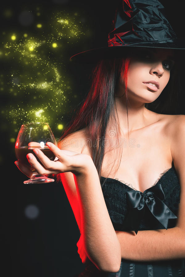 Free Halloween Party 2016! Beautiful Woman Like Witch Holding Cocktail Stock Image - 78345911