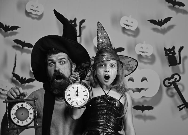 Halloween party and celebration concept. Father and daughter in costumes. stock photo