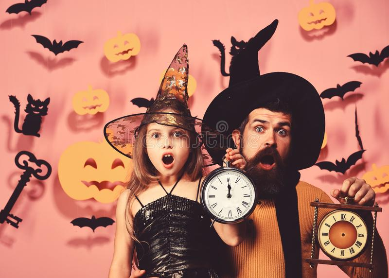 Halloween party and celebration concept. Father and daughter in costumes. royalty free stock photography