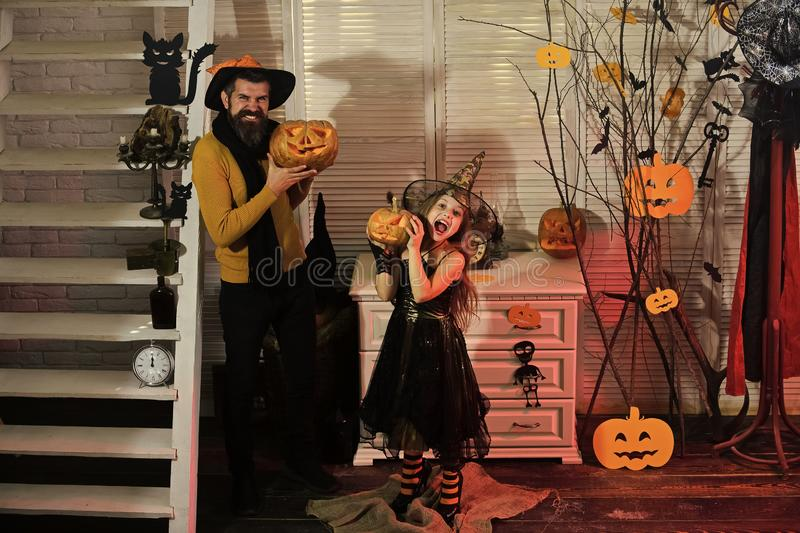 Halloween party and celebration concept. Father and daughter royalty free stock photography