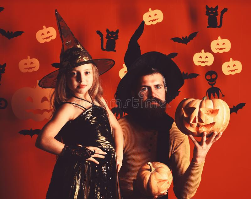 Halloween party and celebration concept. Girl and bearded man. Halloween party and celebration concept. Girl and bearded men with serious faces on red background royalty free stock images