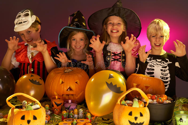 Halloween party with children. Wearing fancy costumes stock photo