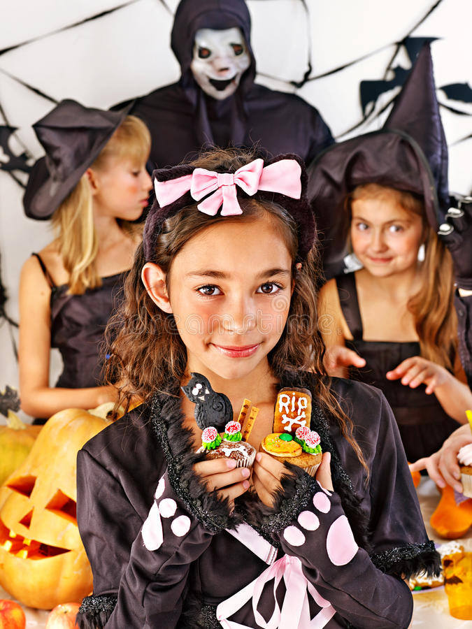 Halloween party with children holding trick or treat. stock image