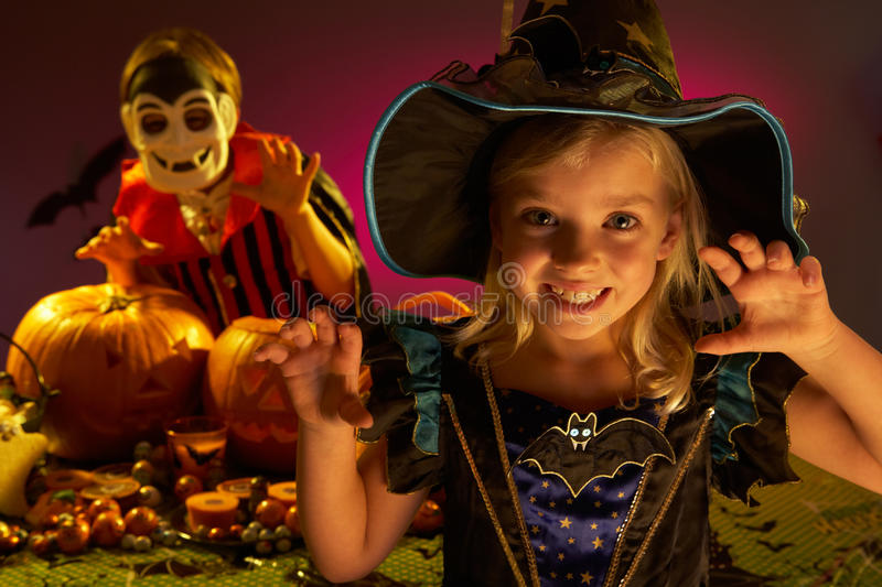 Halloween party with children wearing costumes. Halloween party with children wearing scaring costumes stock image