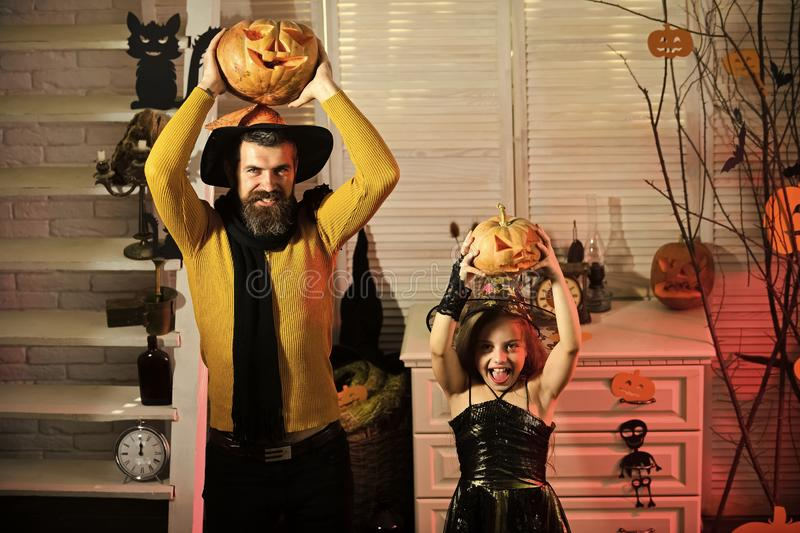 Halloween party concept. Girl and bearded man with cheerful faces. Halloween party concept. Girl and bearded men with cheerful faces on red spooky carnival room royalty free stock photo