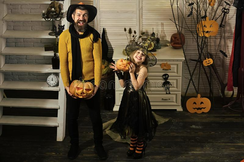 Halloween party concept. Girl and bearded man with smiling faces. Halloween party concept. Girl and bearded men with smiling faces on spooky carnival room royalty free stock photography