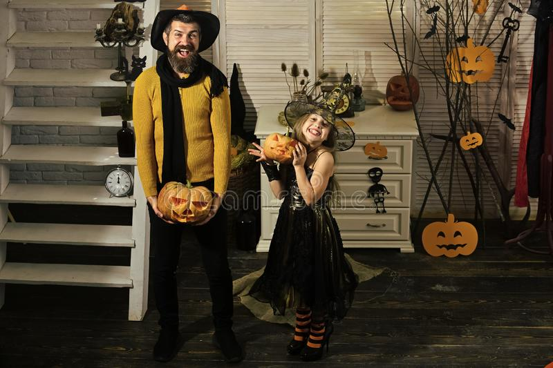 Halloween party concept. Girl and bearded man with smiling faces. Halloween party concept. Girl and bearded men with smiling faces on spooky carnival room stock images
