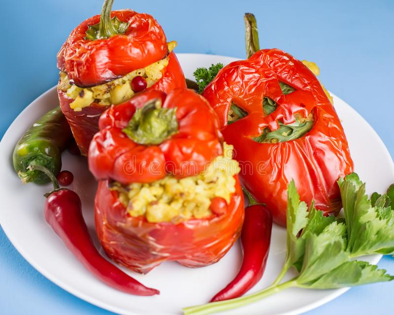 Halloween party food. Red stuffed peppers with scary cutout faces close up. Top view royalty free stock photography