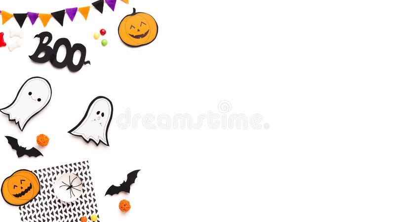 Halloween party and holiday background with paper ghosts stock photo