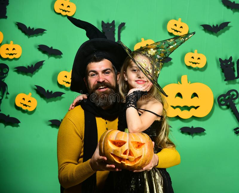 Halloween party and holiday concept. Father and daughter in costumes royalty free stock photo