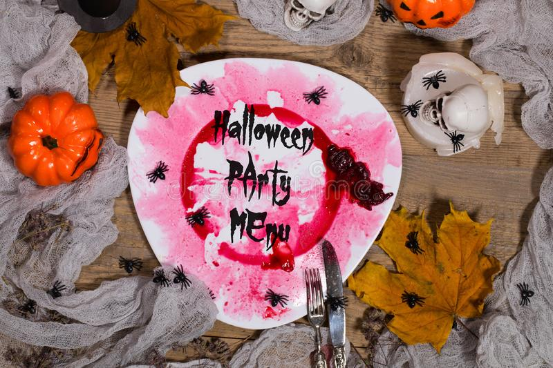 Halloween Party Menu. Dirty plate with silver cutlery on Hallow stock photography