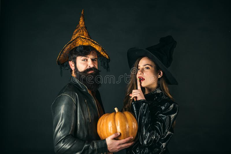 Halloween Party people. Fashion Glamour Halloween. Happy gothic couple in Halloween costume. royalty free stock image