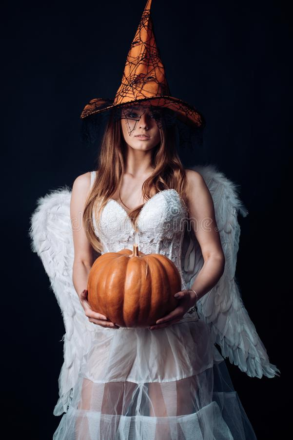 Halloween people in angel costume. Happy Halloween Angelic Witch. Halloween Party girl. Beauty Halloween angel girl with stock image