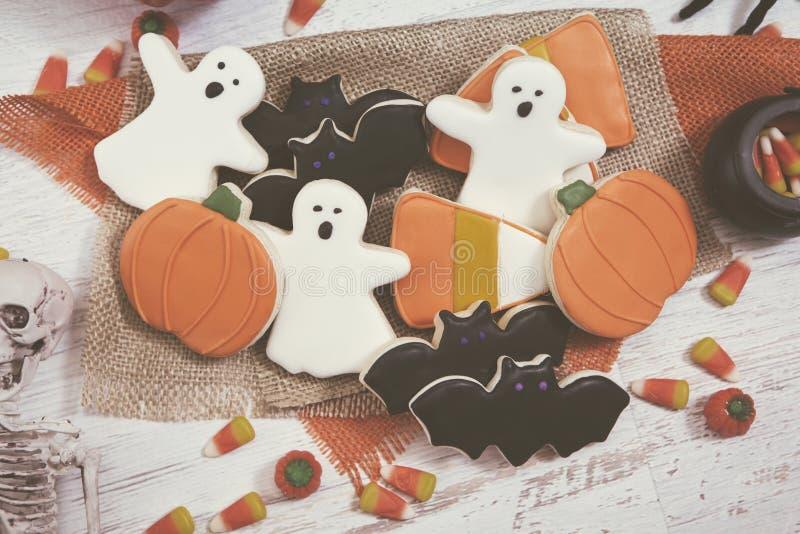Halloween-Plätzchen-Hintergrund getont lizenzfreie stockfotos