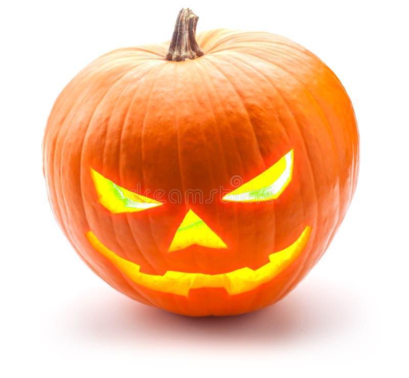 Halloween-pompoen die op de kwaadste die manier grijnzen, op wit wordt geïsoleerd stock afbeeldingen