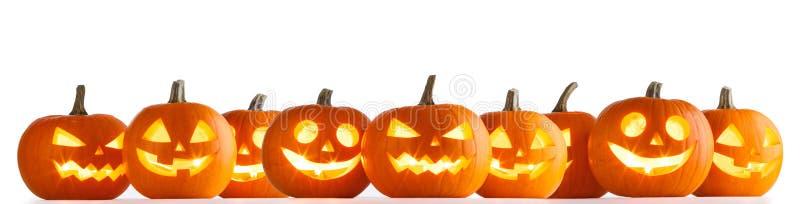 Halloween-pompoenen op wit royalty-vrije stock afbeeldingen