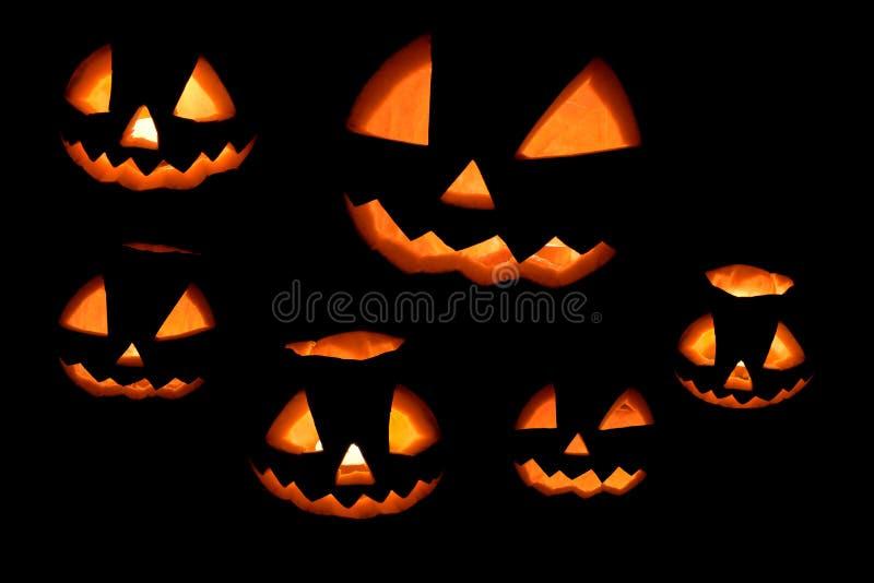 Halloween-pompoenreeks op een zwarte wordt geïsoleerd die stock fotografie