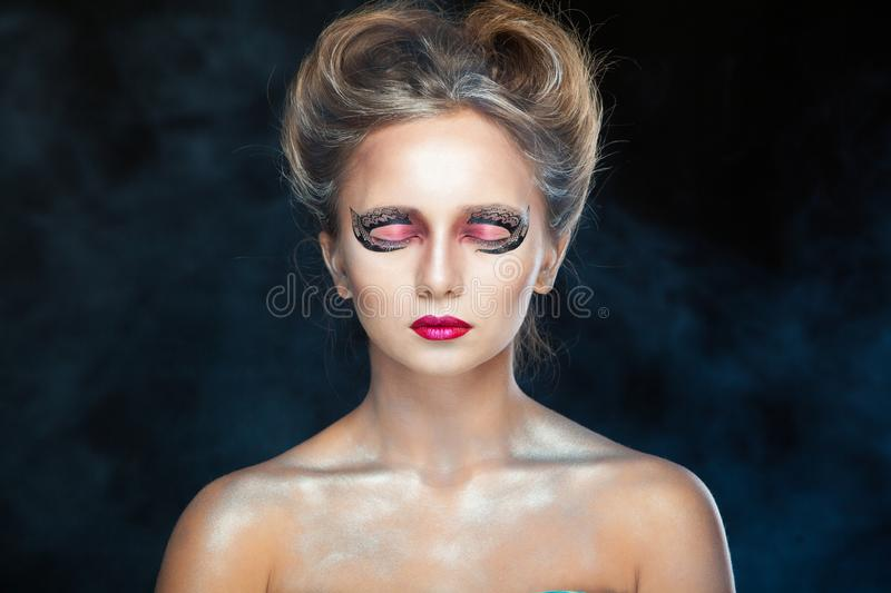 Electronic cigarette wiper. Halloween. Portrait of young beautiful girl with make-up. E-cigarette smoke, Viper. Isolated stock photography