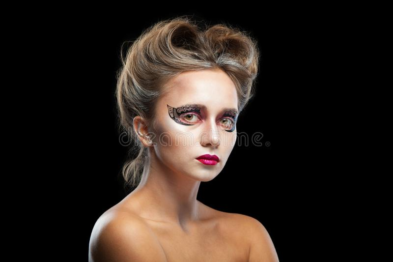 Halloween. Portrait of young beautiful girl with make-up. Isolated on black background. royalty free stock photo