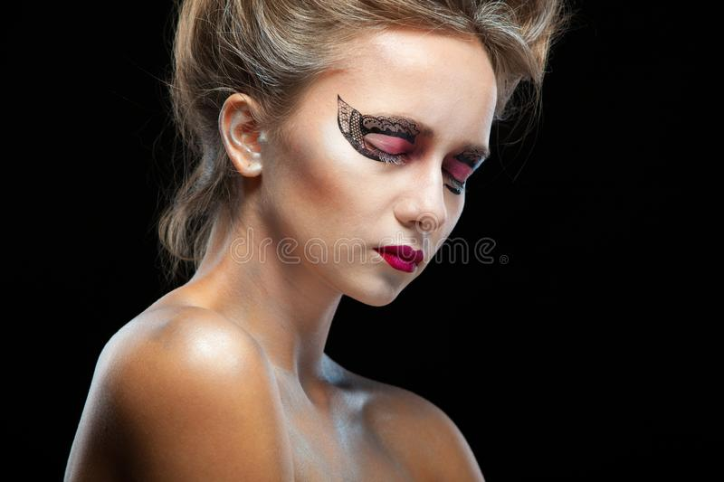 Halloween. Portrait of young beautiful girl with make-up. Isolated on black background. royalty free stock images