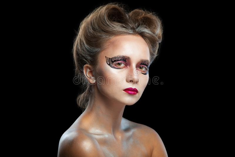 Halloween. Portrait of young beautiful girl with make-up. Isolated on black background. royalty free stock photography