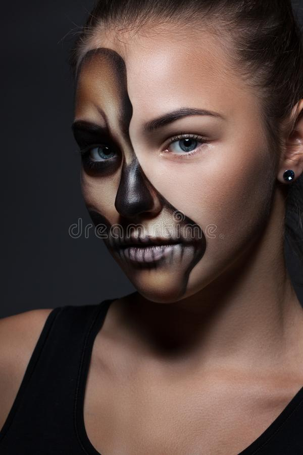 Halloween. Portrait of young beautiful girl with make-up skeleton stock images