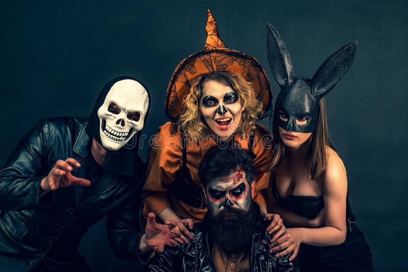 Halloween poster or greeting card - people concept. Halloween Party group. Best friends celebrated Halloween. stock photography