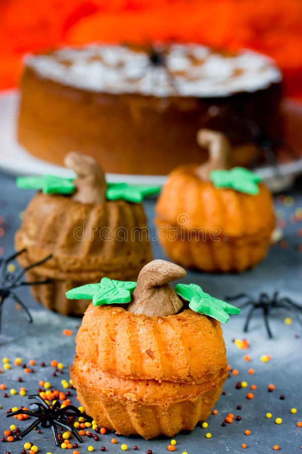 Halloween pumpkin cupcakes for trick or treat night. Homemade Halloween pumpkin cupcakes for trick or treat night stock photo