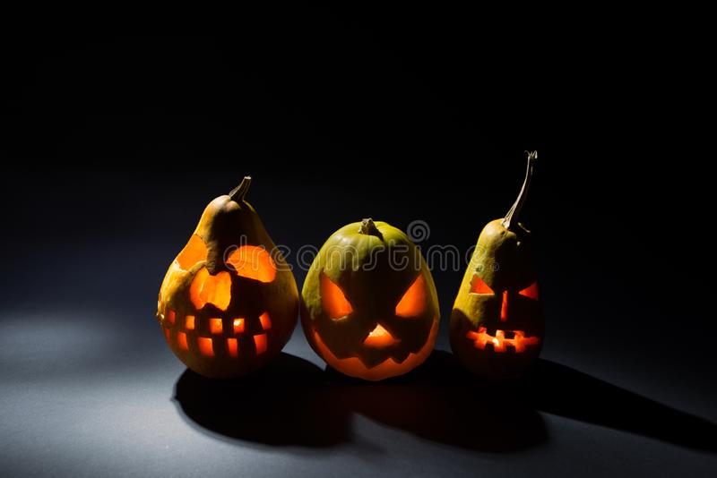 Halloween pumpkin on dark background on holiday, three different pumpkin backgrounds wallpaper royalty free stock photos