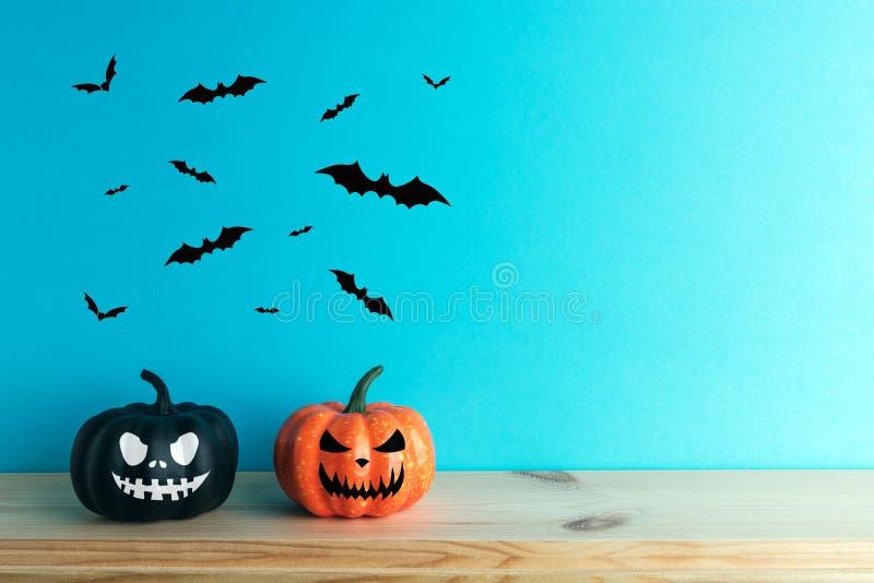 Halloween pumpkin decor with funny faces. Creative Halloween minimal concept.  royalty free stock photos