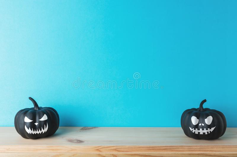 Halloween pumpkin decor with funny faces. Creative Halloween minimal concept.  royalty free stock images