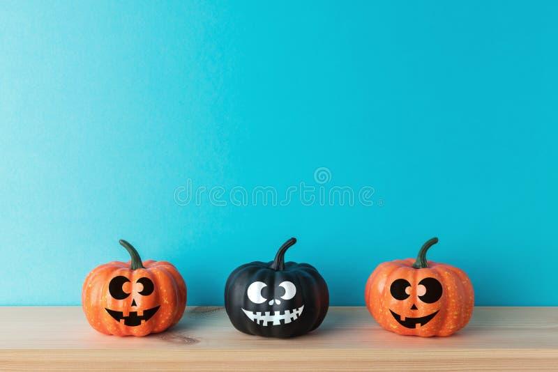 Halloween pumpkin decor with funny faces. Creative Halloween minimal concept.  royalty free stock photography