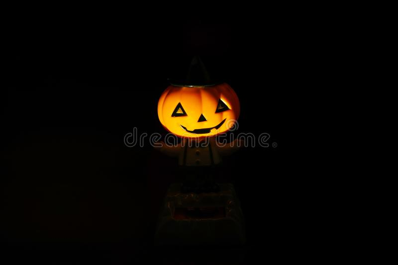 Halloween pumpkin face in dark background stock photos