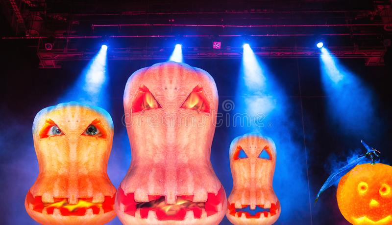 Fantasy view of halloween pumpkin flaming faces with  blue ray projector lights. Halloween pumpkin flaming faces with  blue ray projector lights stock images